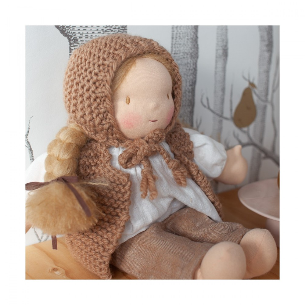Hanknitted gilet and beguin